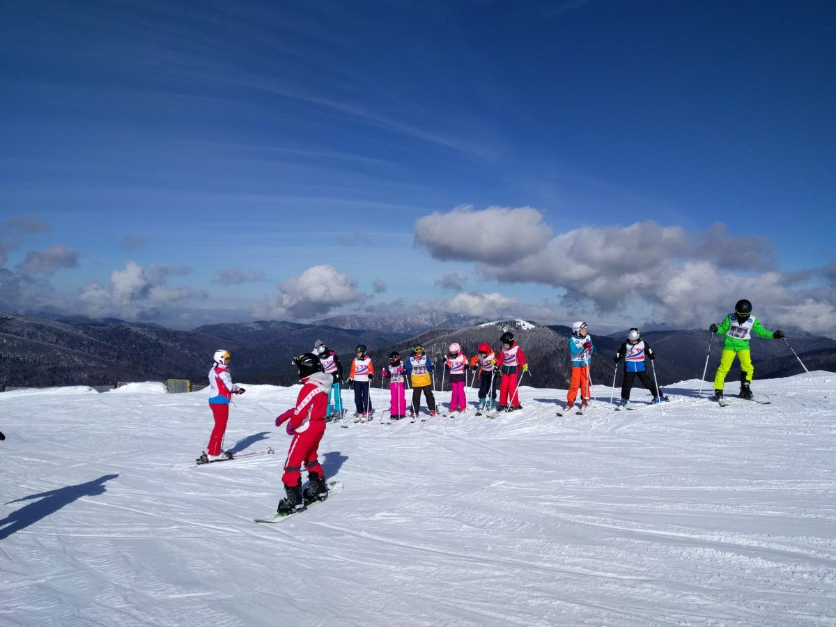 Skiers near Sorica cable car terminal
